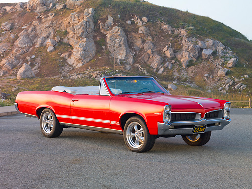 AUT 22 RK2826 01 © Kimball Stock 1967 Pontiac OHC Sprint Convertible Red 3/4 Front View On Pavement By Sand Dune