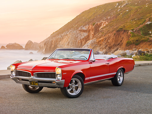 AUT 22 RK2827 01 © Kimball Stock 1967 Pontiac OHC Sprint Convertible Red 3/4 Front View On Pavement By Sand Dune