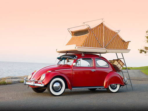 AUT 22 RK2829 01 © Kimball Stock 1964 Volkwagen Beetle Red With Topper Tent 3/4 Front View On Pavement By Ocean