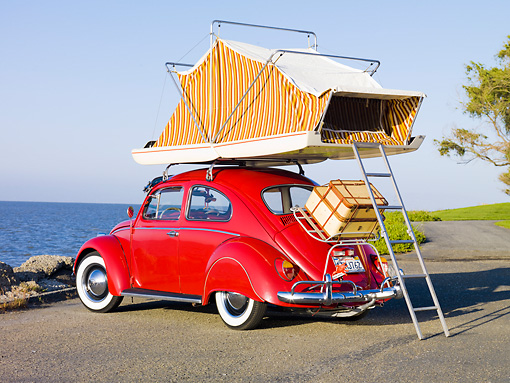AUT 22 RK2831 01 © Kimball Stock 1964 Volkwagen Beetle Red With Topper Tent 3/4 Rear View On Pavement By Ocean