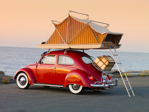 AUT 22 RK2832 01 © Kimball Stock 1964 Volkwagen Beetle Red With Topper Tent 3/4 Rear View On Pavement By Ocean