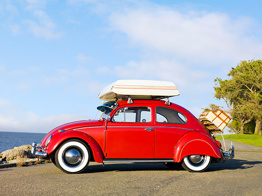 AUT 22 RK2837 01 © Kimball Stock 1964 Volkwagen Beetle Red With Topper Tent Profile View On Pavement By Ocean