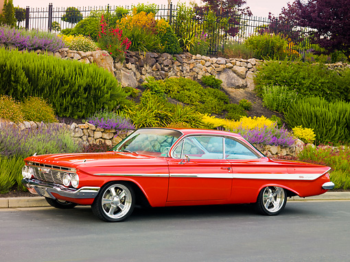 AUT 22 RK2845 01 © Kimball Stock 1961 Chevrolet Impala SS Red 3/4 Front View On Pavement