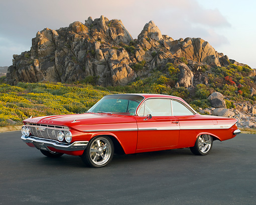 AUT 22 RK2847 01 © Kimball Stock 1961 Chevrolet Impala SS Red 3/4 Front View On Pavement