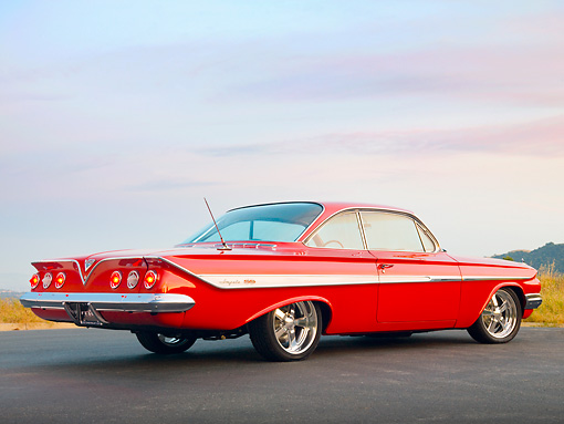 AUT 22 RK2851 01 © Kimball Stock 1961 Chevrolet Impala SS Red 3/4 Rear View On Pavement