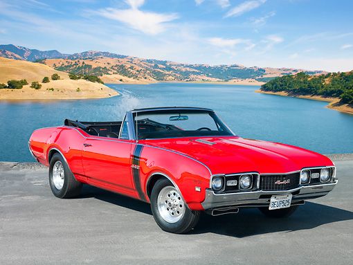 AUT 22 RK2853 01 © Kimball Stock 1968 Oldsmobile 442 W-30 Convertible Red 3/4 Front View On Pavement By Lake