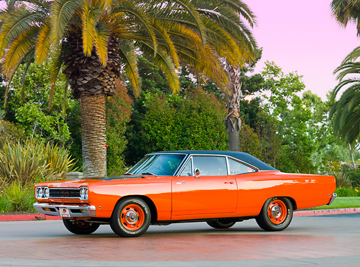 AUT 22 RK2862 01 © Kimball Stock 1968 Plymouth Road Runner Orange 3/4 Front View On Pavement By Trees