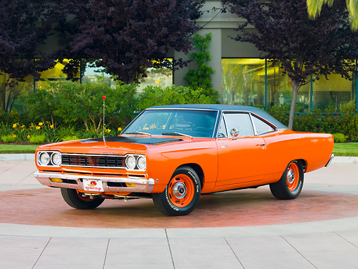 AUT 22 RK2863 01 © Kimball Stock 1968 Plymouth Road Runner Orange 3/4 Front View On Pavement By Trees