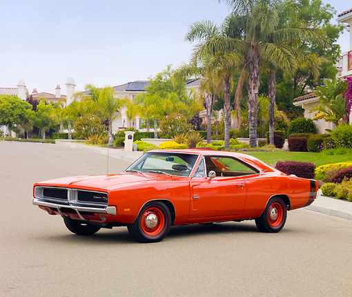 AUT 22 RK2865 01 © Kimball Stock 1969 Dodge Charger R/T Hemi Red 3/4 Front View On Pavement By Trees And Houses