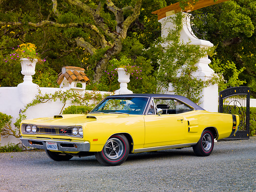 AUT 22 RK2873 01 © Kimball Stock 1969 Dodge Coronet R/T Yellow 3/4 Front View On Pavement By Wall