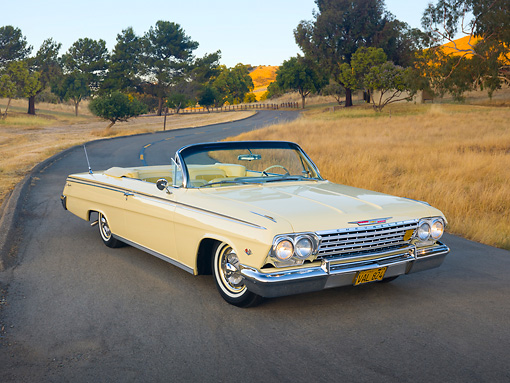 AUT 22 RK2892 01 © Kimball Stock 1962 Chevrolet Impala Convertible Yellow 3/4 Front View On Pavement By Hills