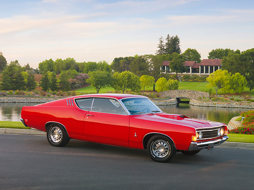 AUT 22 RK2906 01 © Kimball Stock 1969 Ford Torino 428 Cobra Jet Red 3/4 Front View On Pavement By Lake