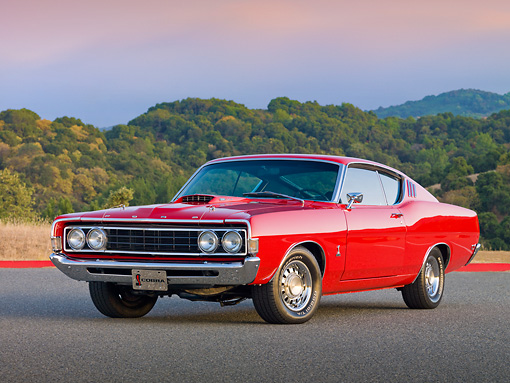 AUT 22 RK2910 01 © Kimball Stock 1969 Ford Torino 428 Cobra Jet Red 3/4 Front View On Pavement By Hills