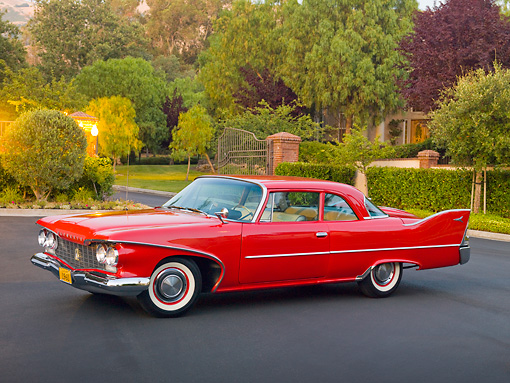 AUT 22 RK2920 01 © Kimball Stock 1960 Plymouth Savoy Red 3/4 Front View On Pavement By Trees