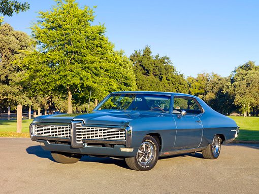 AUT 22 RK2923 01 © Kimball Stock 1968 Pontiac Grand Prix Blue 3/4 Front View On Pavement By Trees