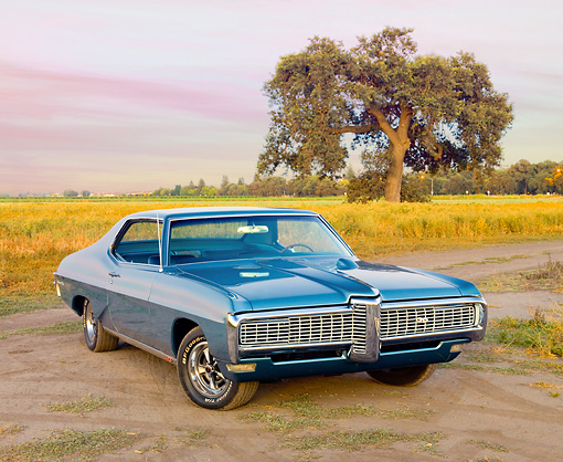 AUT 22 RK2925 01 © Kimball Stock 1968 Pontiac Grand Prix Blue 3/4 Front View On Dirt Road By Field And Tree