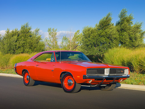 AUT 22 RK2936 01 © Kimball Stock 1969 Dodge Hemi Charger R/T Red 3/4 Front View On Pavement By Trees