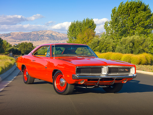 AUT 22 RK2937 01 © Kimball Stock 1969 Dodge Hemi Charger R/T Red 3/4 Front View On Pavement By Trees