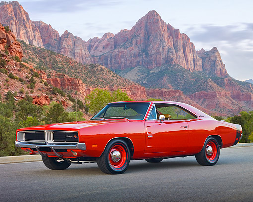 AUT 22 RK2939 01 © Kimball Stock 1969 Dodge Hemi Charger R/T Red 3/4 Front View On Pavement By Red Rock