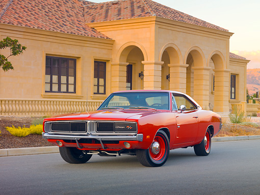 AUT 22 RK2940 01 © Kimball Stock 1969 Dodge Hemi Charger R/T Red 3/4 Front View On Pavement By House