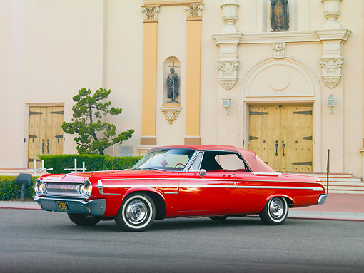 AUT 22 RK2945 01 © Kimball Stock 1964 Dodge Polara 500 Convertible Red 3/4 Front View On Pavement By Building