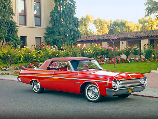 AUT 22 RK2950 01 © Kimball Stock 1964 Dodge Polara 500 Convertible Red 3/4 Front View On Pavement By Garden