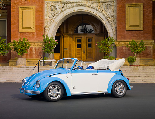 AUT 22 RK2960 01 © Kimball Stock 1969 Volkswagen Beetle Convertible Light Blue And White 3/4 Front View On Pavement By Building
