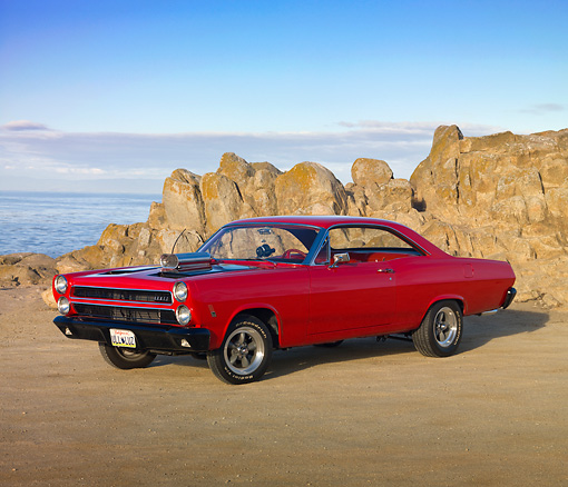 AUT 22 RK2963 01 © Kimball Stock 1966 Mercury Cyclone Rio Red 3/4 Front View On Sand By Ocean
