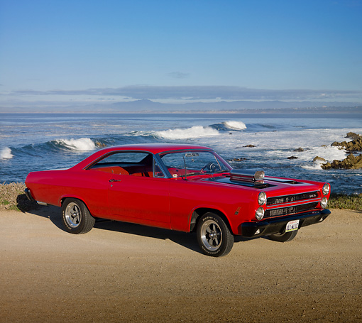 AUT 22 RK2967 01 © Kimball Stock 1966 Mercury Cyclone Rio Red 3/4 Front View On Sand By Ocean