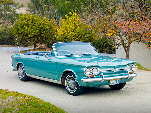 AUT 22 RK2982 01 © Kimball Stock 1964 Chevrolet Corvair Monza Convertible Green 3/4 Front View On Pavement By Trees