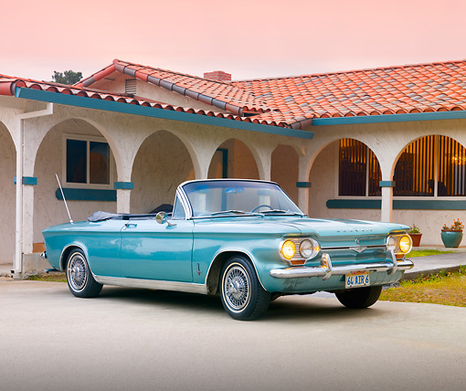 AUT 22 RK2983 01 © Kimball Stock 1964 Chevrolet Corvair Monza Convertible Green 3/4 Front View On Driveway By House