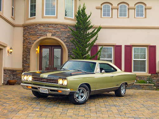 AUT 22 RK2984 01 © Kimball Stock 1969 Plymouth GTX Ice Green 3/4 Front View On Brick By House