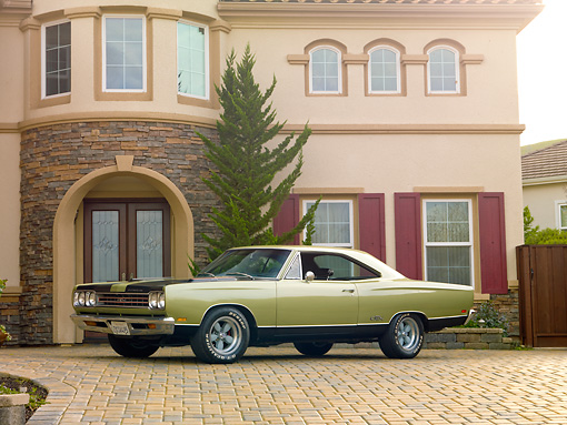 AUT 22 RK2985 01 © Kimball Stock 1969 Plymouth GTX Ice Green 3/4 Front View On Brick By House