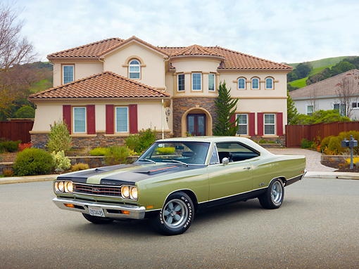 AUT 22 RK2986 01 © Kimball Stock 1969 Plymouth GTX Ice Green 3/4 Front View On Pavement By House