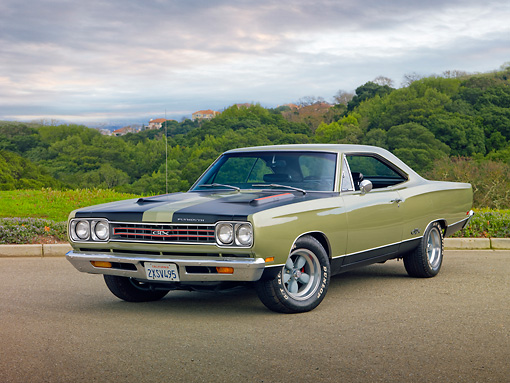 AUT 22 RK2988 01 © Kimball Stock 1969 Plymouth GTX Ice Green 3/4 Front View On Road By Trees
