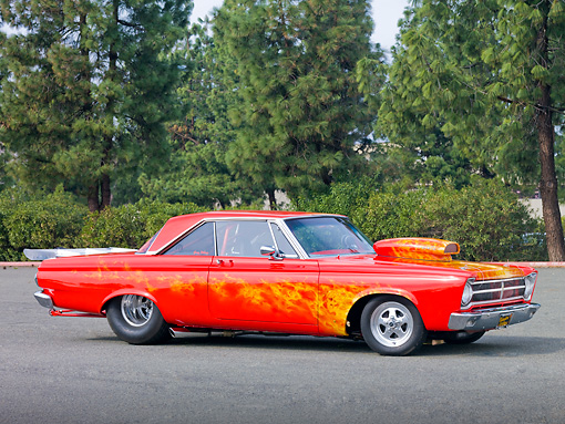 AUT 22 RK2992 01 © Kimball Stock 1965 Plymouth Belvedere Red With Flames 3/4 Side View On Pavement With Trees