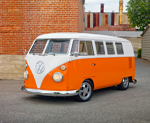 AUT 22 RK3002 01 © Kimball Stock 1965 Volkswagen Kombi Microbus Orange And White 3/4 Front View On Pavement By Brick Wall