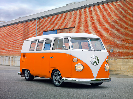 AUT 22 RK3004 01 © Kimball Stock 1965 Volkswagen Kombi Microbus Orange And White 3/4 Front View On Pavement By Brick Wall