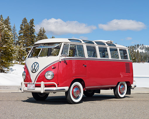 AUT 22 RK3012 01 © Kimball Stock 1960 Volkswagen 23 Window Microbus Red And White 3/4 Front View On Pavement By Snow And Trees