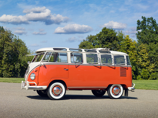AUT 22 RK3013 01 © Kimball Stock 1960 Volkswagen 23 Window Microbus Orange And White 3/4 Side View On Pavement By Trees