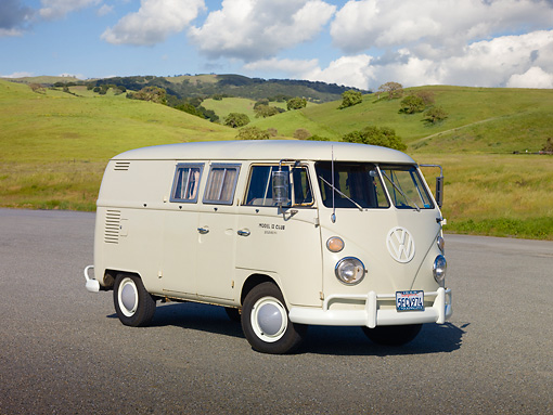 AUT 22 RK3019 01 © Kimball Stock 1966 VW Sundial Camper Pearl White 3/4 Front View On Pavement By Grassy Hill
