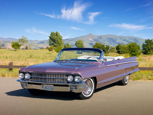 AUT 22 RK3023 01 © Kimball Stock 1962 Cadillac El Dorado Convertible Heather 3/4 Front View On Pavement By Field
