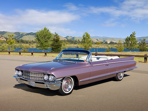 AUT 22 RK3024 01 © Kimball Stock 1962 Cadillac El Dorado Convertible Heather 3/4 Front View On Pavement By Lake