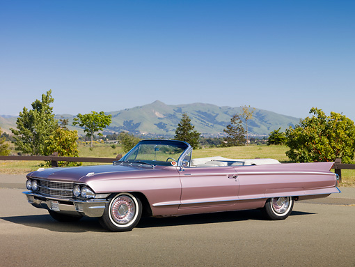 AUT 22 RK3028 01 © Kimball Stock 1962 Cadillac El Dorado Convertible Heather 3/4 Front View On Pavement By Field
