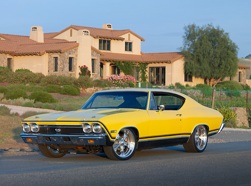 AUT 22 RK3034 01 © Kimball Stock 1968 Chevrolet Chevelle SS 396 Yellow 3/4 Front View On Pavement By House