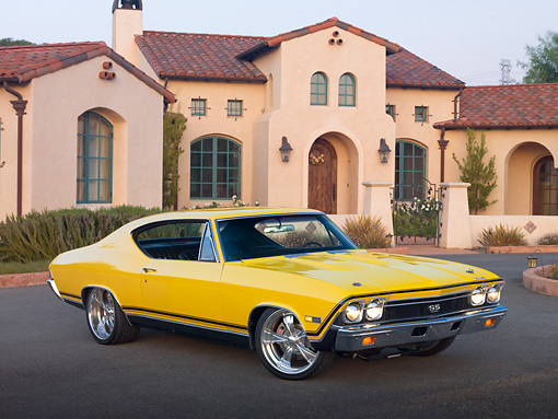 AUT 22 RK3035 01 © Kimball Stock 1968 Chevrolet Chevelle SS 396 Yellow 3/4 Front View On Pavement By House
