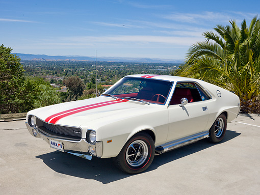 AUT 22 RK3046 01 © Kimball Stock 1969 AMC AMX White With Red Stripe 3/4 Front View On Pavement By Palm Tree