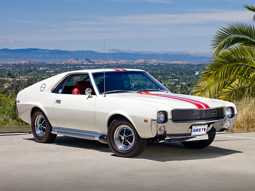 AUT 22 RK3047 01 © Kimball Stock 1969 AMC AMX White With Red Stripe 3/4 Front View On Pavement By Palm Tree