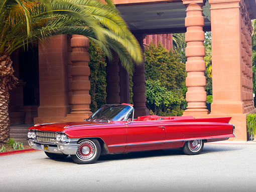 AUT 22 RK3053 01 © Kimball Stock 1962 Cadillac Series 62 Convertible Red 3/4 Front View On Pavement By Trees And Building