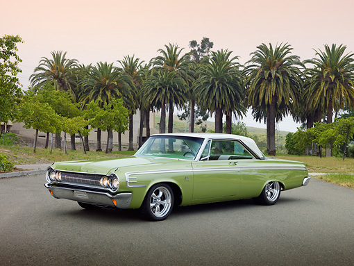 AUT 22 RK3061 01 © Kimball Stock 1964 Dodge 440 2-Door Hardtop Green 3/4 Front View On Pavement By Palm Trees